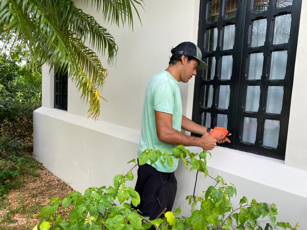 Man performing home maintenance in Costa Rica