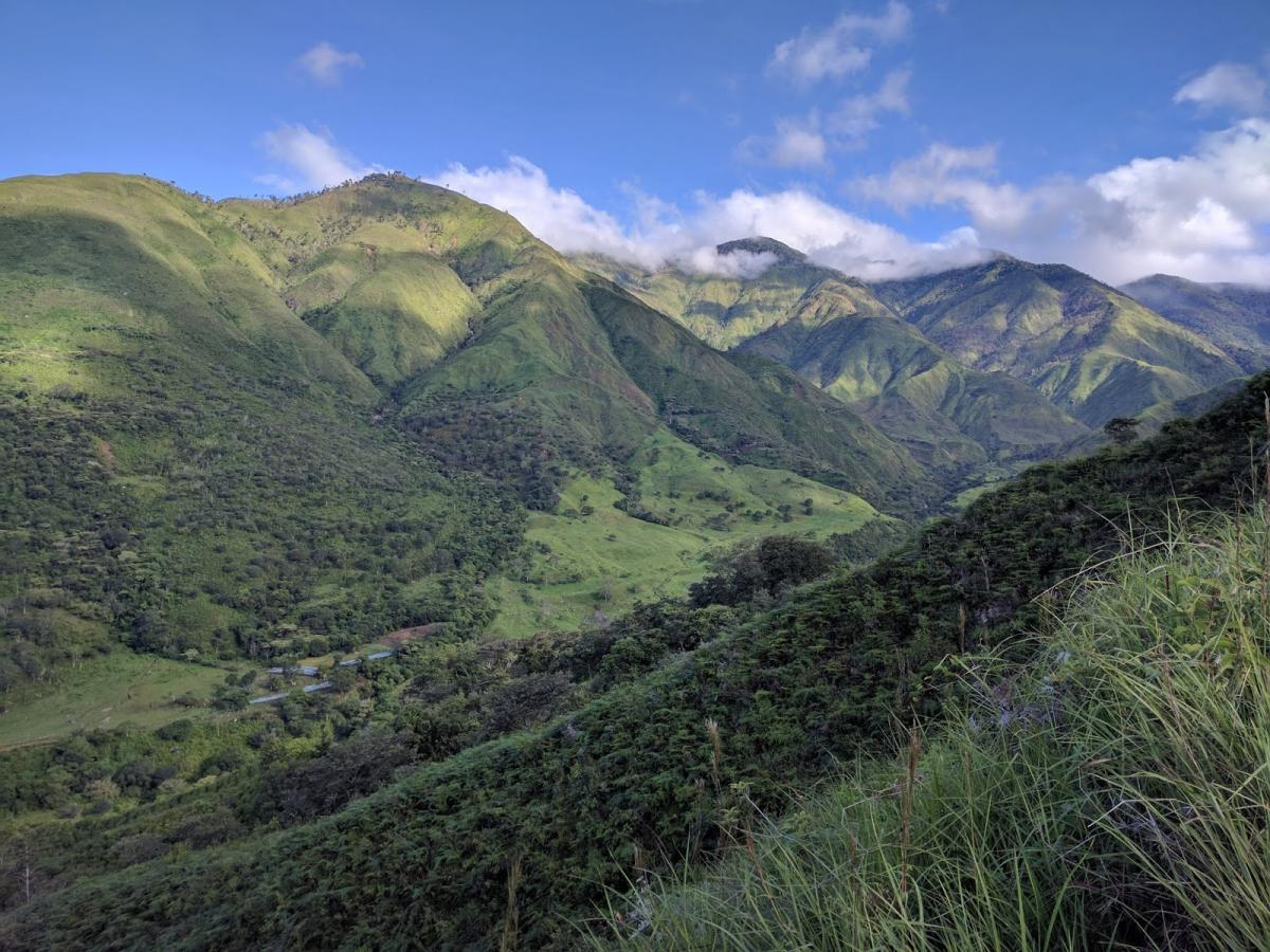 Photo of a valley surrounded by green hills in Costa Rica